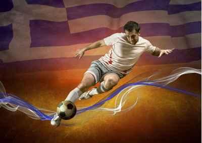 Ποδοσφαιριστής με την Ελληνική σημαία